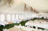 M <3 white weddings! gorgeous hanging branch centerpieces // photo by Jonathan Wherrett