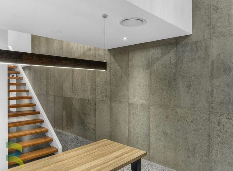 Exposed Concrete Walls Void With Ducted Air Hanging Long Light
