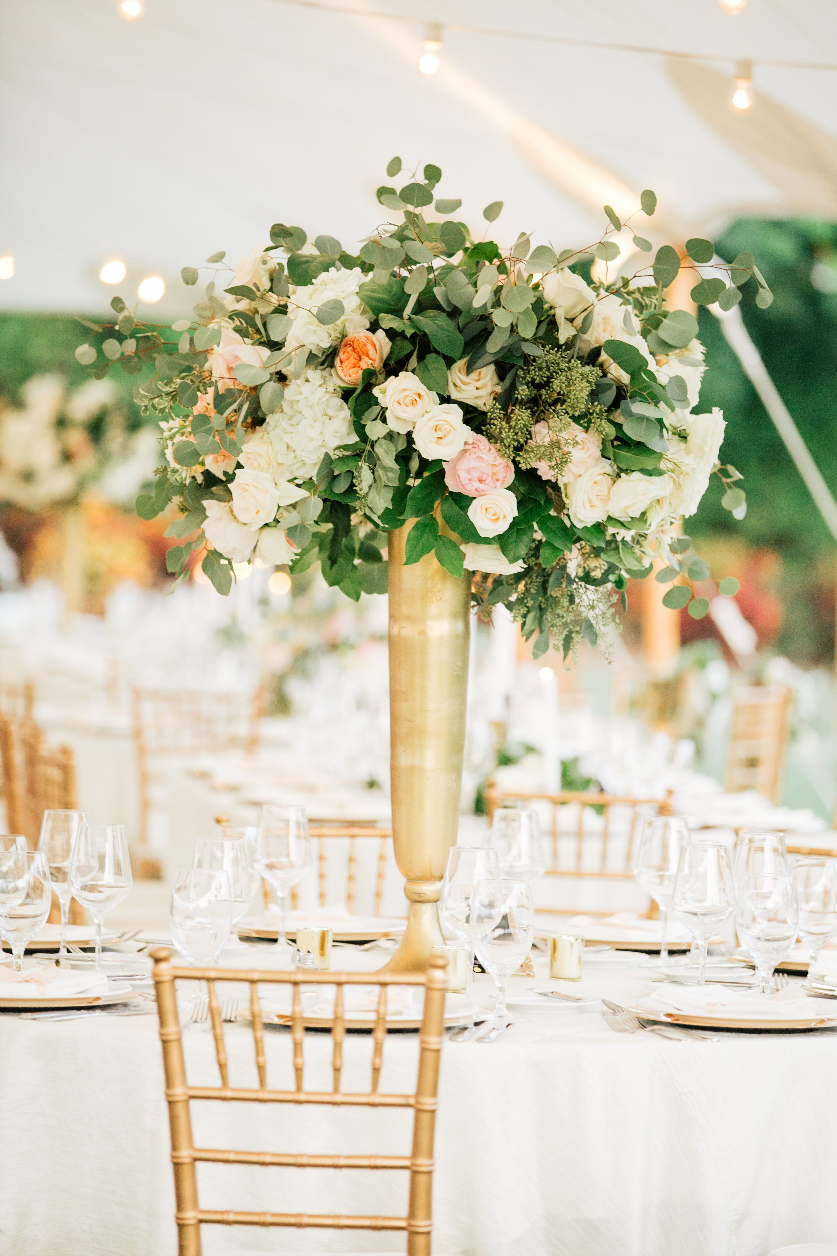 Wedding reception decoration ideas with lights  Sailcloth tent Sperry tent Tented wedding Tall centerpiece