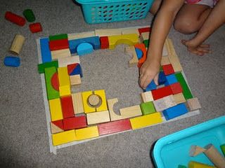 DIY block puzzles - use the small table top blocks for this - make 2 or 3 shapes on table with masking tape - let kids figure out how to fill