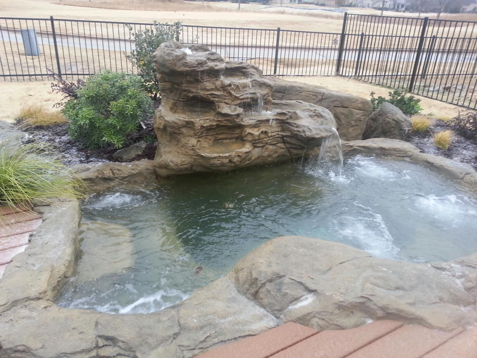 This extra large pond is shown as a hot tub spa with jets for Garden pond tub