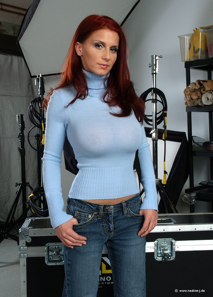 Busty Redhead In Sweater And Jeans