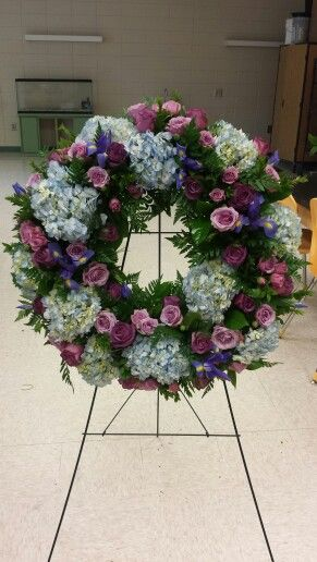 Fresh Flower Hydrangea Funeral Wreath In Purple And Blue With Spray Roses And Iris Funeral Floral Funeral Flower Arrangements Funeral Flowers