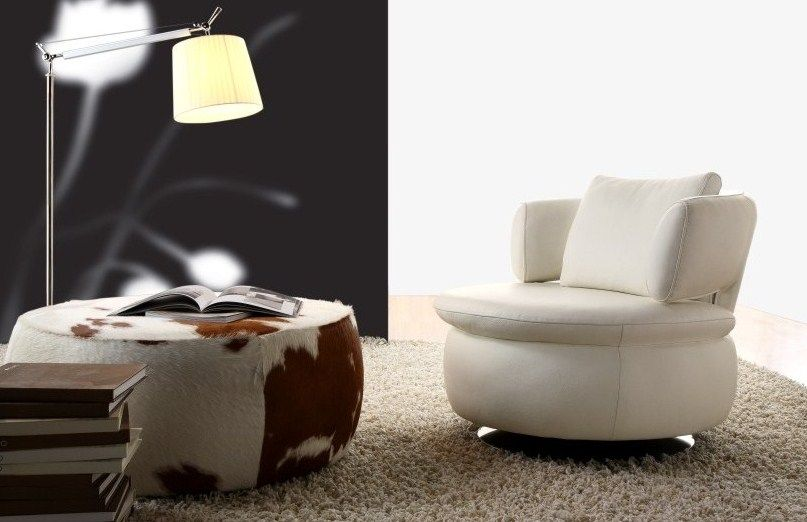 Cowhide Ottoman & Leather swivel chair. Comfort, warmth, quality and fantastic design!