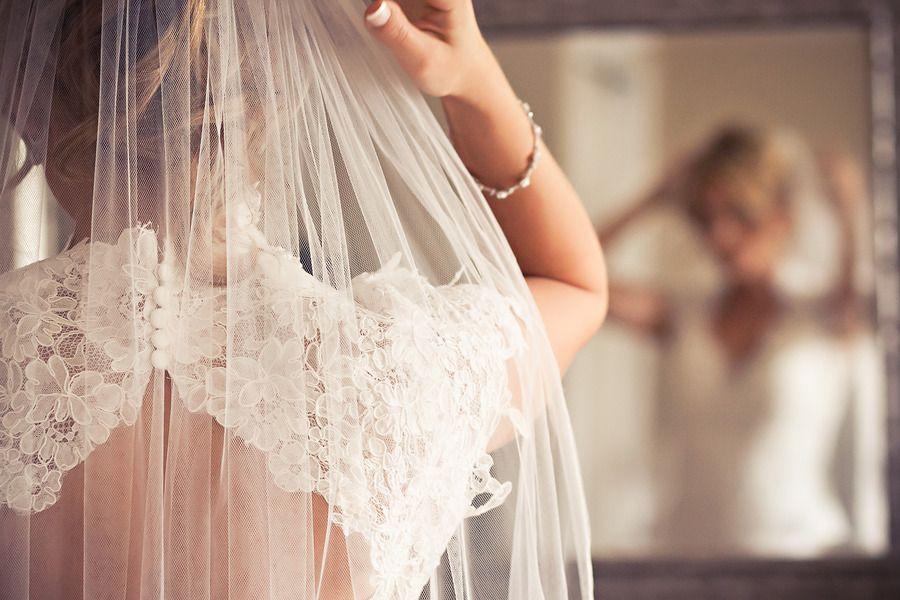 Veil and lace keyhole back wedding dress. Stunning detail shot! See the post at http://tulleandtwine.com/2013/9/24/its-little-things