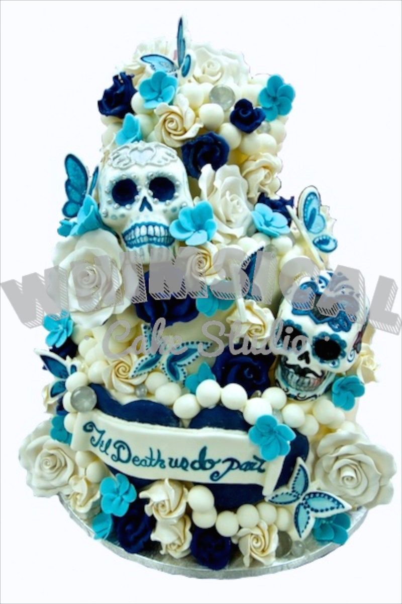 Sugar skull wedding cake. Til death us do part. Covered in chocolate roses and butterflies.