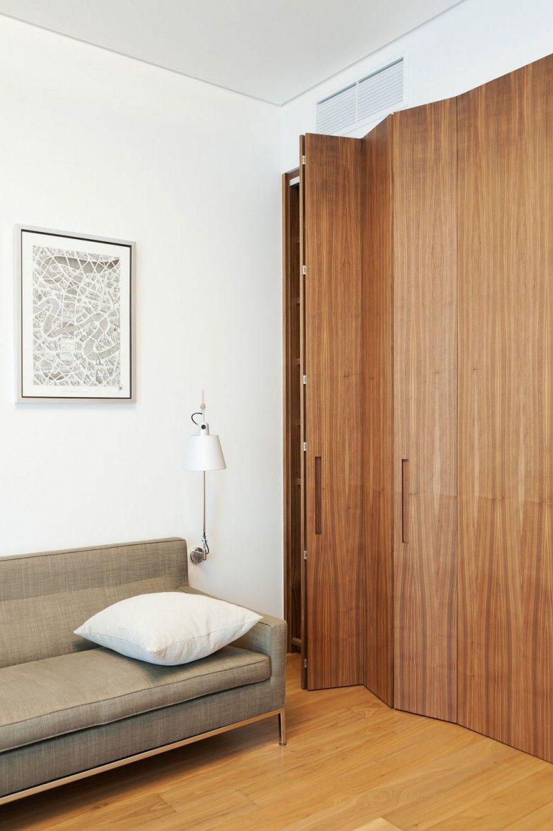 Interior Minimalist Apartment Interior In Ostozhenka Street Wood Wardrobe With Folded Cover With Images Modern Closet Doors Bifold Closet Doors Bedroom Closet Doors