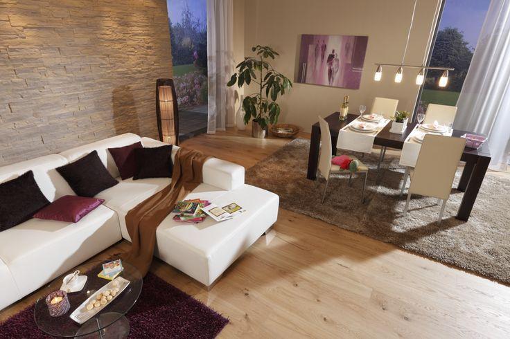 wohnzimmer esszimmer beige braun steinwand laminat teppich