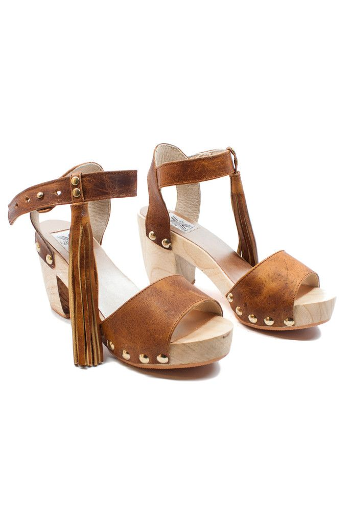 Throw it back to the 70's with these iconic fringe clogs!