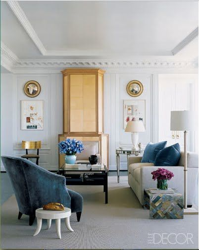 Living room - molding, gold accents, blue accents, eclectic