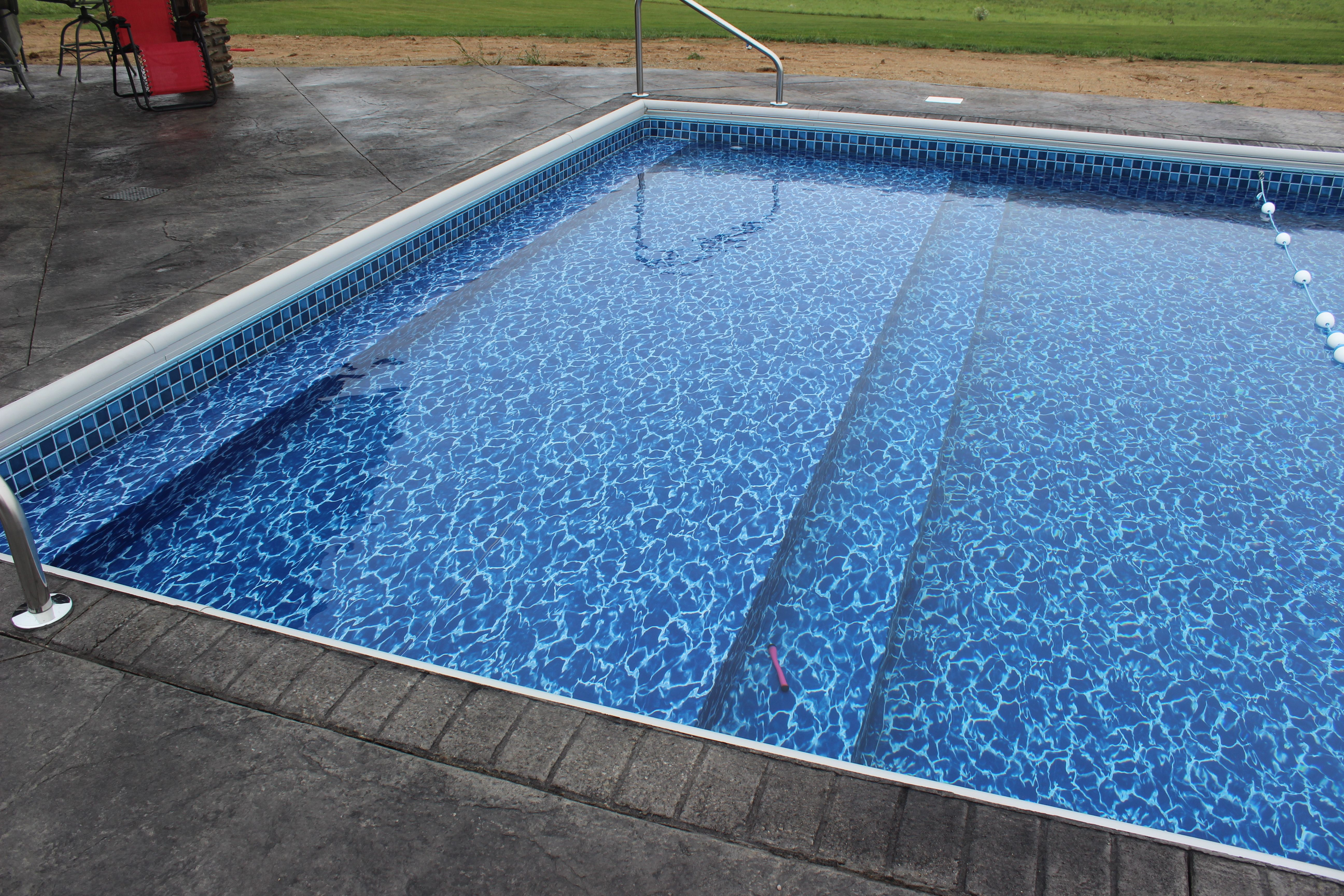 Vinyl Liner Swimming Pool With Sun Deck And Full Width Steps Raft