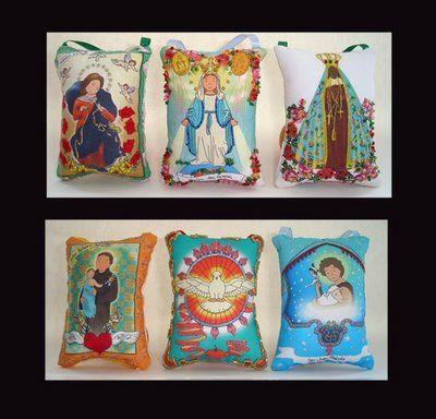 http://camelonovidades.blogspot.com.br/2009/02/almofadas-de-santinhos.html