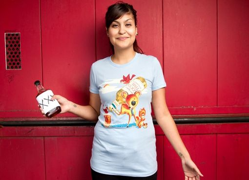 Katie Campbelltakes the child-like look of classic animal art and twists it into a much more grown-up scene with Bambi and pals going on some whiskey.  #tee #tshirt #tops