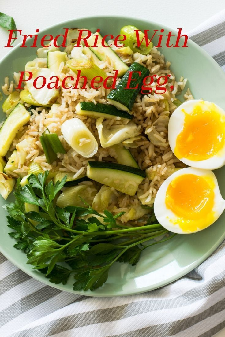 Rice With Poached Egg Fried Rice With Poached Egg Zucchini And Celery on Round Green Ceramic PlatefoodplatehealthydinnerlunchmealeggdietdishdeliciouscuisinericegreensFrie...