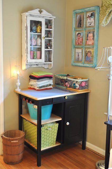 the little cart in the corner...almost looks like a little kitchen island, used as a craft table.  some Ikea shelves on the wall for storage, and this is a cute little crafting/writing corner.