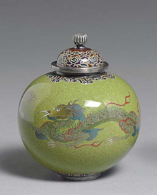 A Small Cloisonné Enamel Jar and Cover Meiji period (cirac 1890), signed Kyoto Namikawa [workshop of Namikawa Yasuyuki, 1845-1927] The ovoid body enamelled tea-green and designed in colored enamels and silver wire with two writhing dragons, the neck and cover decorated with swirling clouds against a brown ground, the foot with a formal lappet band; silver mounts and silver chrysanthemum-form finial; signature on silver tablet mounted to base 3¼in. (8.2cm.) high