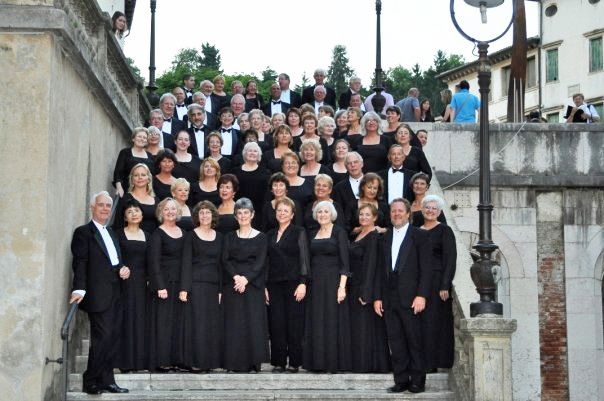Sarasota's Key Chorale flanked by Executive Director Richard Storm and Maestro Joseph Caulkins prior to the Chorale's 2009 concert in Asolo, Treviso Province, Italy. The 110 voice Chorale is noted for collaborating with other arts groups such as the Sarasota Opera, Sarasota Ballet, Circus Sarasota, abd Sarasota Young Voices, to bring celebrated musical works to the cultural coast of Florida and to Sarasota's Sister Cities in Europe.
