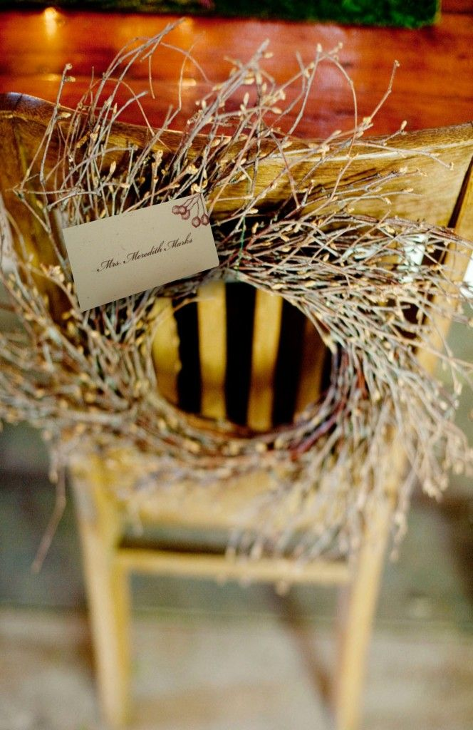 No room on your dining table for everything? Decorate a chair back with a wreath created from foraged twigs that can play double-duty as a place card holder.