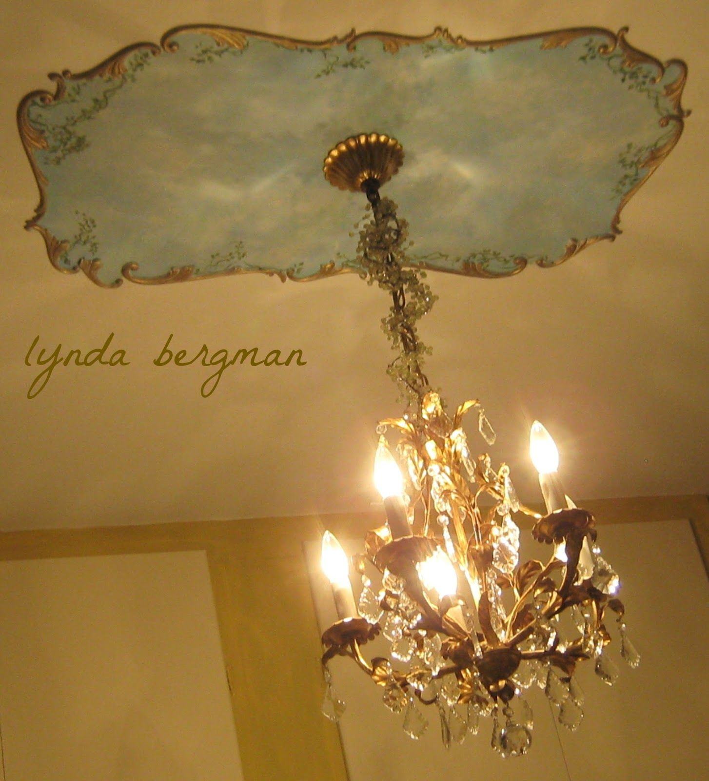 Lynda bergman decorative artisan designing painting a sky ceiling from time to time i paint store bought ceiling medallions for my clients they go at the base of a chandelier or fan and always look so arubaitofo Choice Image