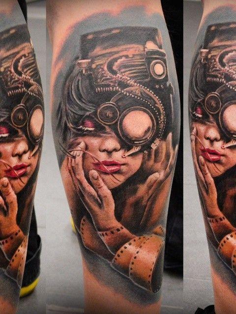 8da47a38a91cc Biomechanical style colored leg tattoo of woman face with strange camera