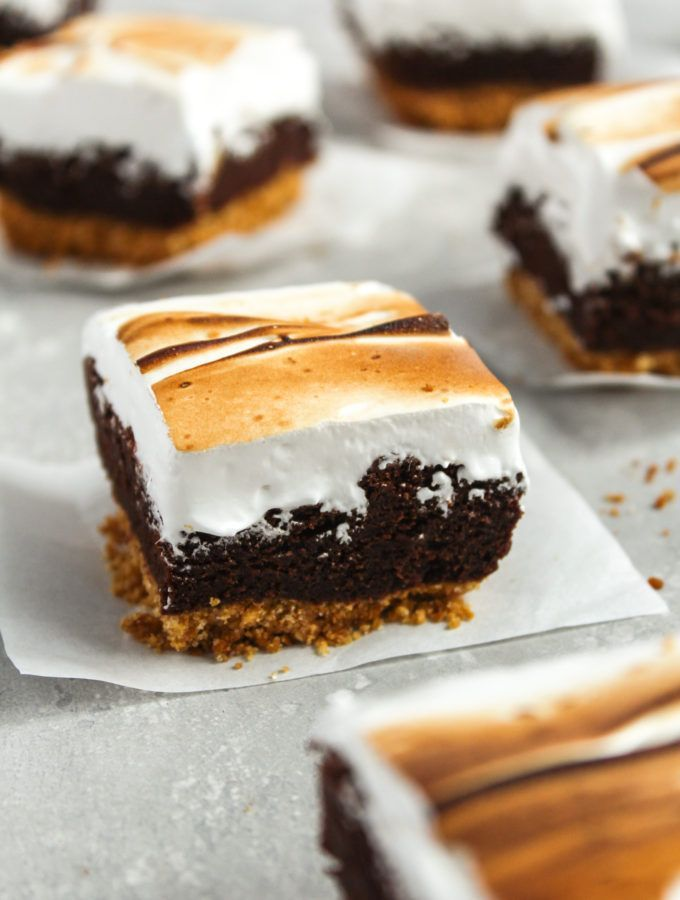 Delicious layers of graham cracker crust, fudgy brownie and toasted meringue make the perfect s'more brownies. These bars can be served year around for a delicious treat. #smores #fudgybrownies #toastedmeringue #homemadegrahamcrackercrust Delicious layers of graham cracker crust, fudgy brownie and toasted meringue make the perfect s'more brownies. These bars can be served year around for a delicious treat. #smores #fudgybrownies #toastedmeringue #homemadegrahamcrackercrust