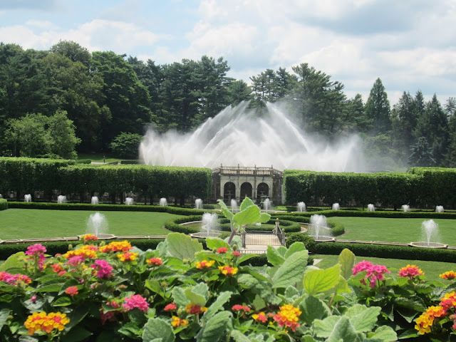 Water Fountain Show And Pink And Yellow Flowers In Longwood Gardens Outside Of Philadelphia