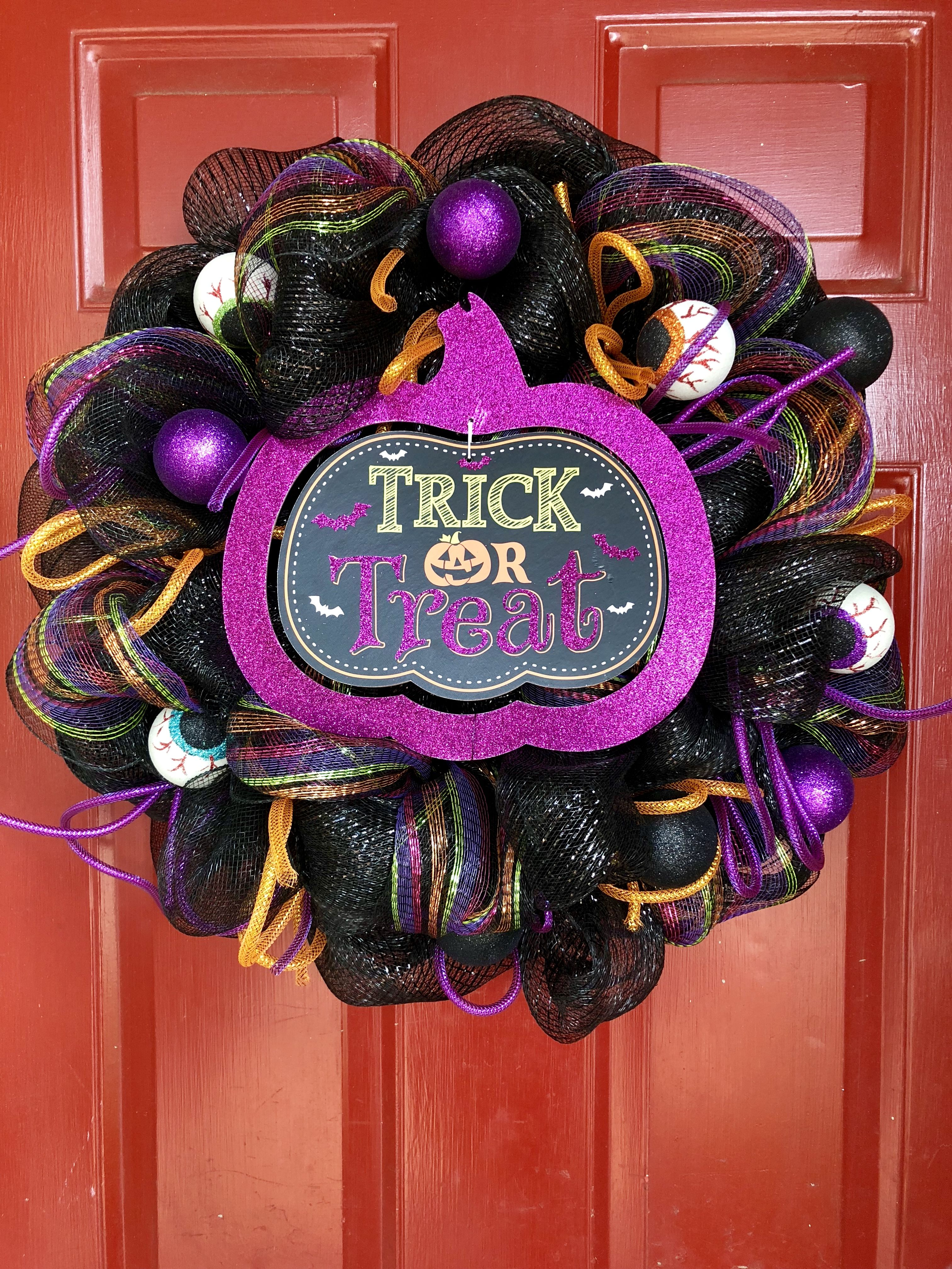 Deco mesh wreath made using tubing and sign from Dollar