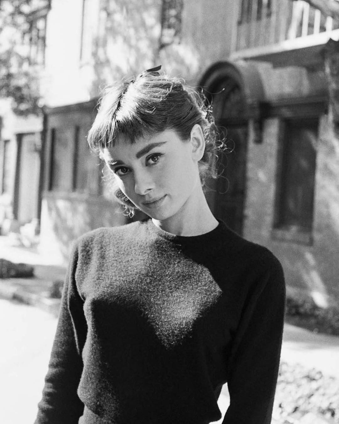 Audrey Hepburn photographed on the set of Sabrina by Mark Shaw, 1953.