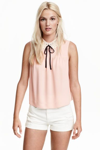 242d2b22d1 Blouse with a lace collar  Sleeveless blouse in a viscose weave with a lace  Peter Pan collar with a sewn-on tie at the neck