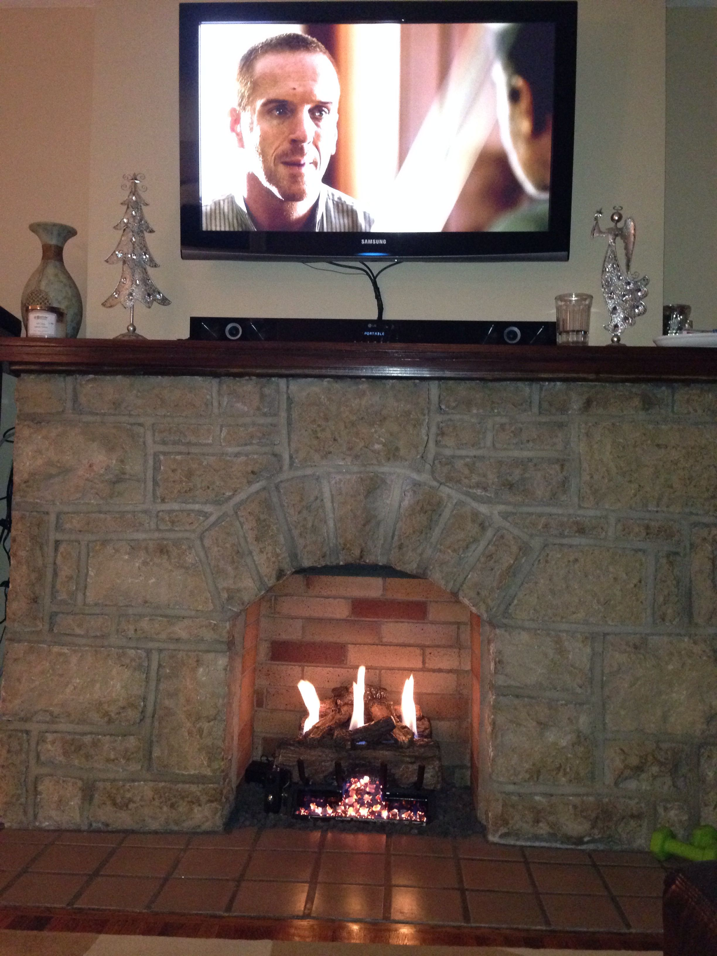 Perfection Ventless Gas Log Fireplace With Television Mounted Above Oh And Homeland On Demand Gas Fireplace Logs Basement Fireplace Fireplace