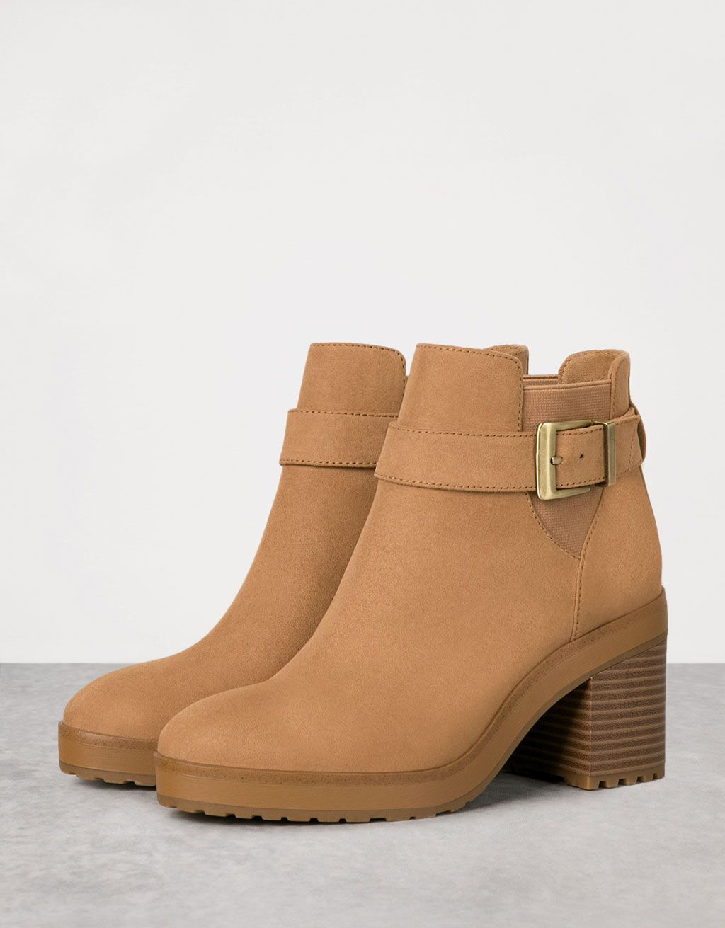 993acdfcbfa5d Mid heel ankle boots with openings and buckle. Discover this and many more  items in Bershka with new products every week