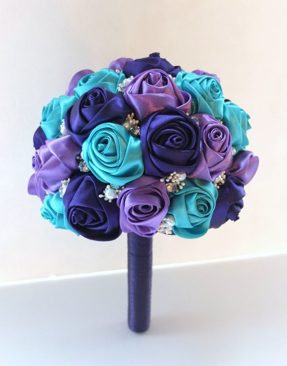 Fabric bouquet satin rose bouquet peacock bouquet purple teal this lovely ribbon rose brooch bouquet is is perfect for a memorable wedding the sphere is approximately 7 in diameter and composed of ribbon izmirmasajfo