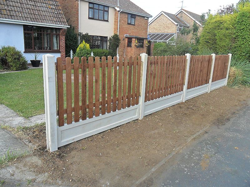 Installation of new picket fence using concrete posts and