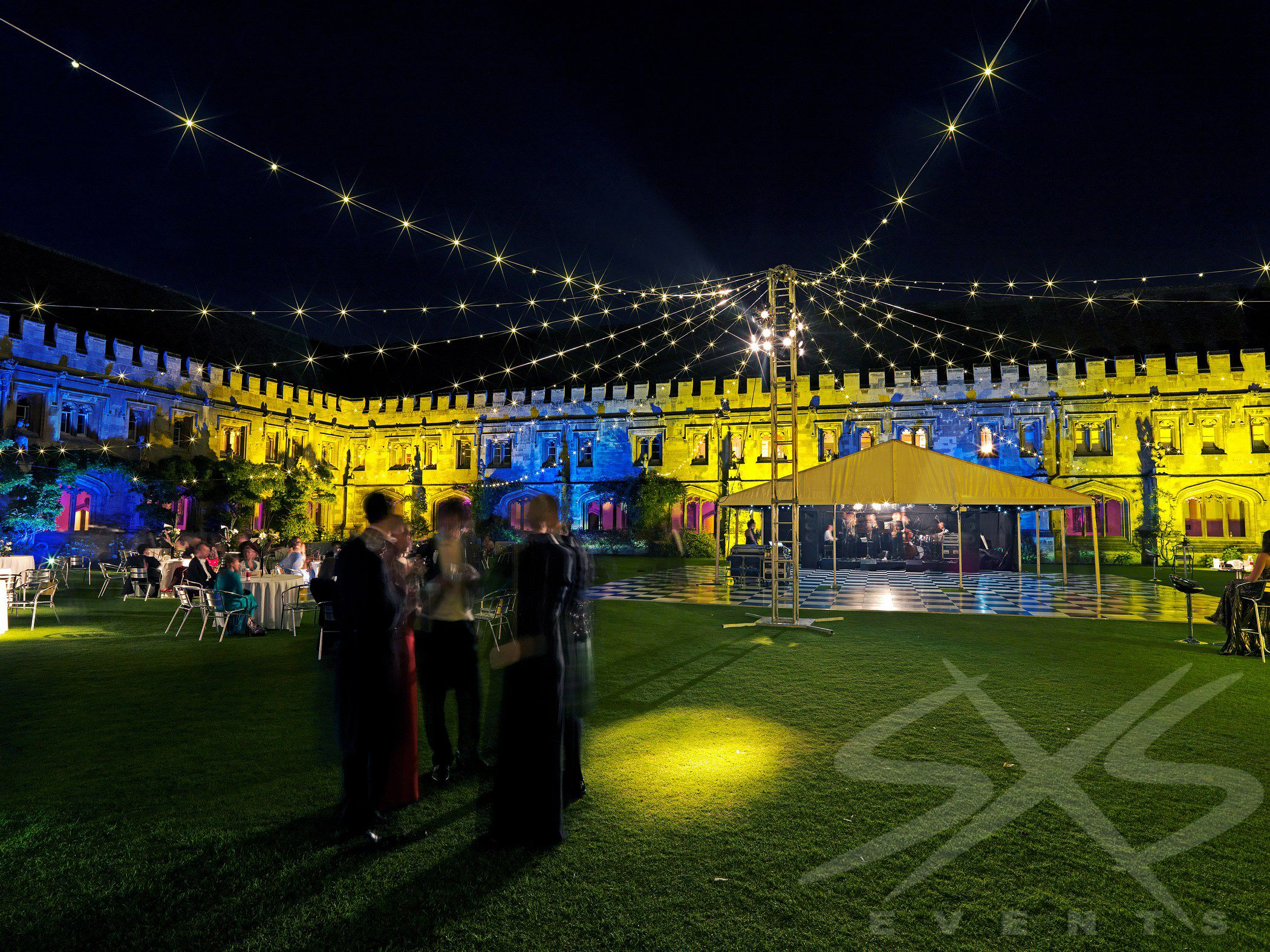 Outdoor fairy light canopy with yellow and blue outdoor outdoor fairy light canopy with yellow and blue outdoor architectural lighting for a college ball aloadofball Choice Image
