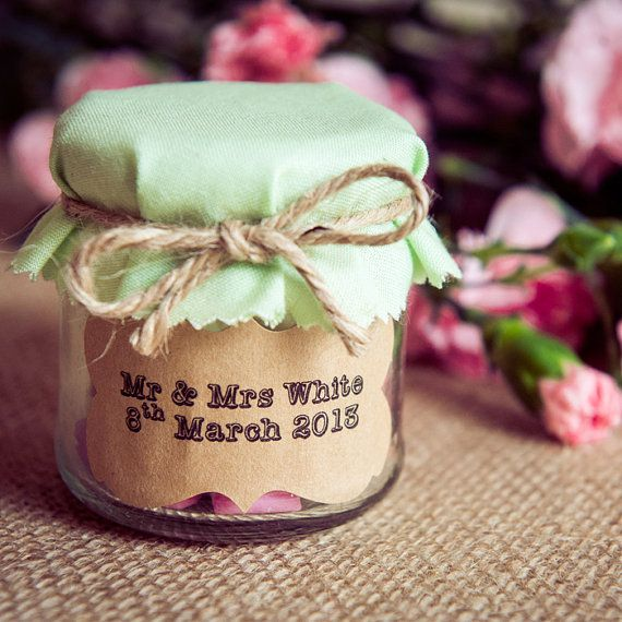 Personalised wedding favour jar decorated with customised sticker green fabric and twine tie