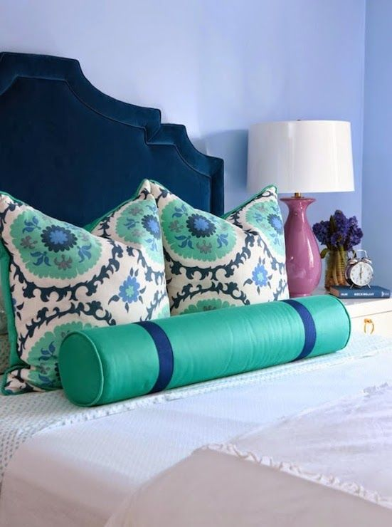 Pretty bedroom with navy velvet headboard accented with teal ...