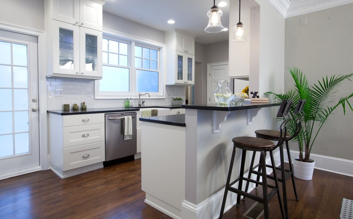 white cabinets and black countertops with white subway tile kitchens