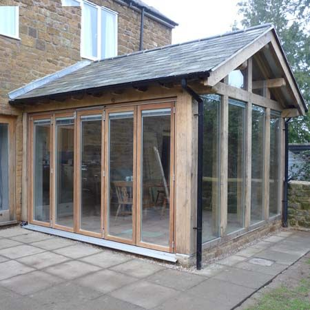 The design centre green oak frame garden room extension for Oak garden rooms