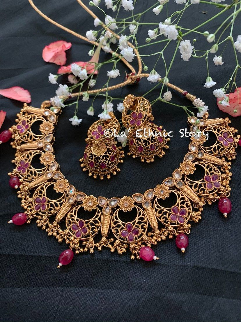 Gold Plated Embossed necklace with Earrings and Tikka