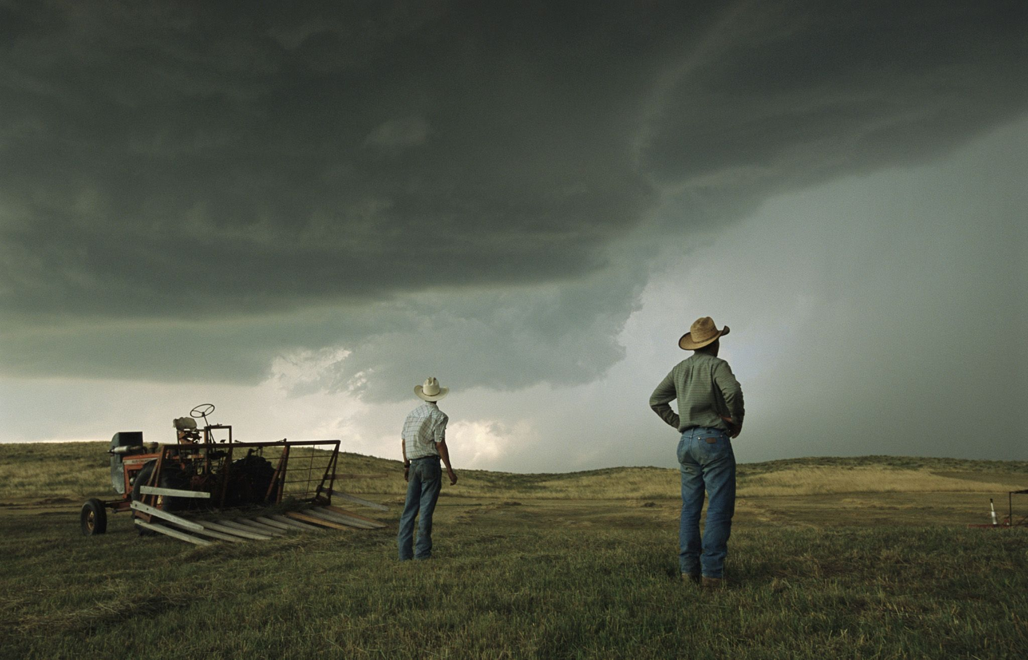 Farmers watch growing storm clouds in the Sand Hills of Ogallala, Nebraska.
