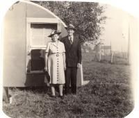 Couple in front of old trailer