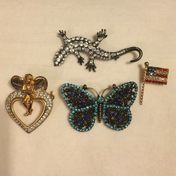 4 different pin/ brooches 4 pins/ brooches lizard butterfly flag and a angel with heart. Jewelry Brooches