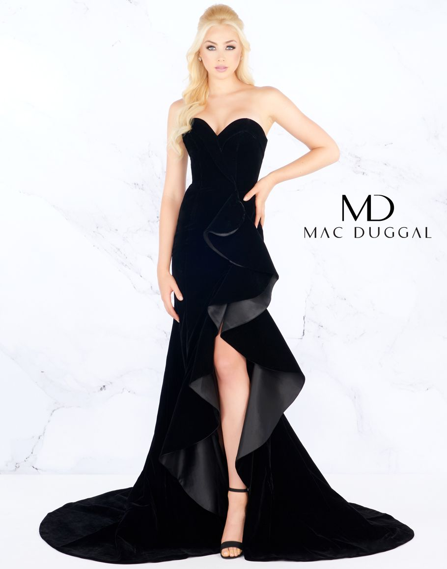 1e608037f0d This strapless velvet gown features a dramatic side ruffle with slit  beginning at the waist