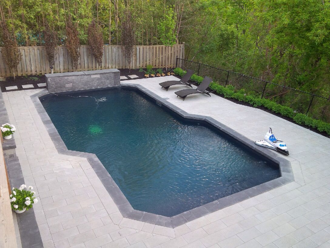Transpave Gigga Slab Paver With A New Pool With A Black Liner