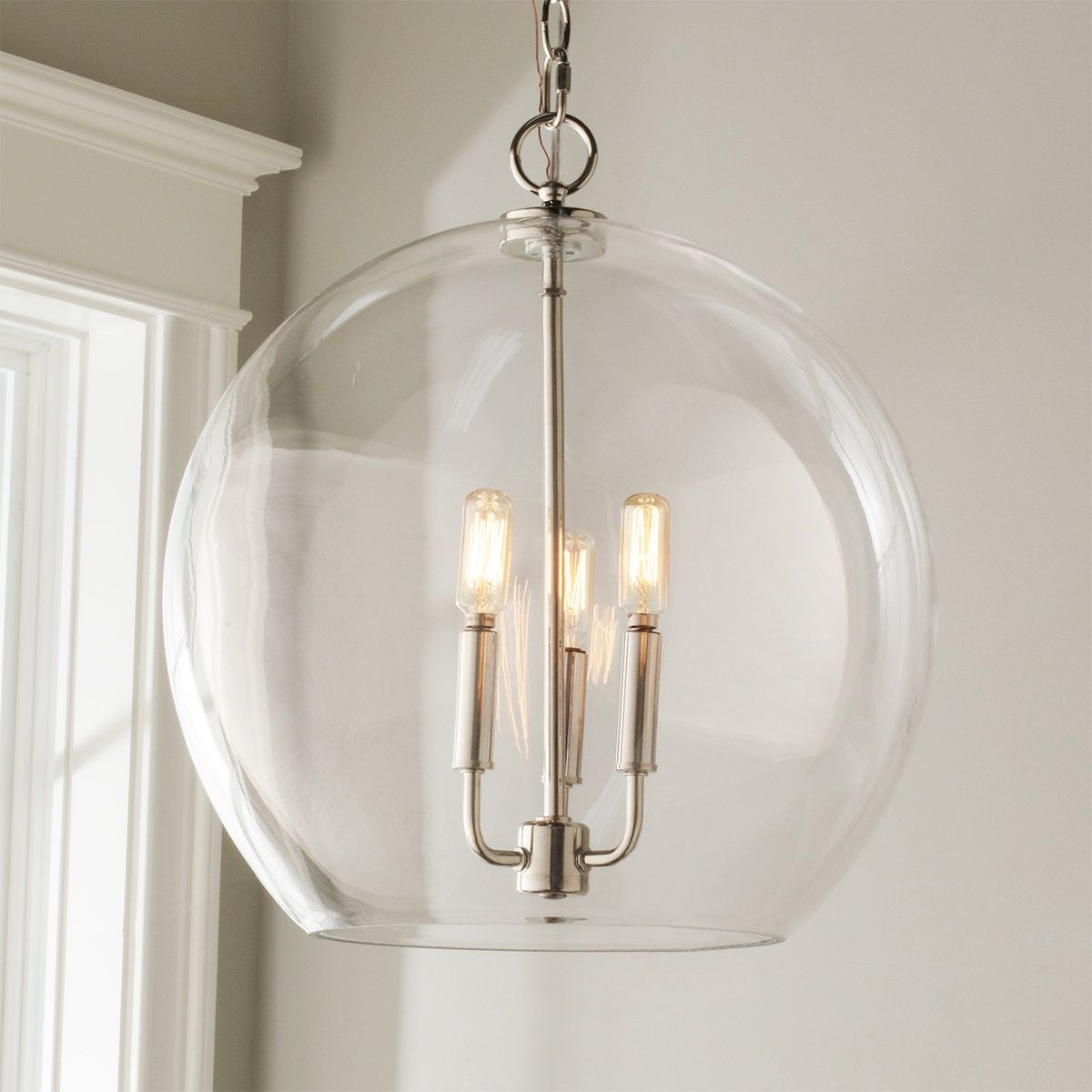 Clearly a winner in versatility and simplicity! This clear glass dome and 3 light cluster of candlelights brightens kitchen tables, foyers and more.
