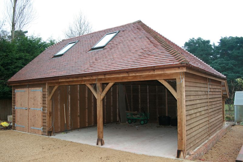 Open fronted wooden garage with logstore garages for Open carport plans