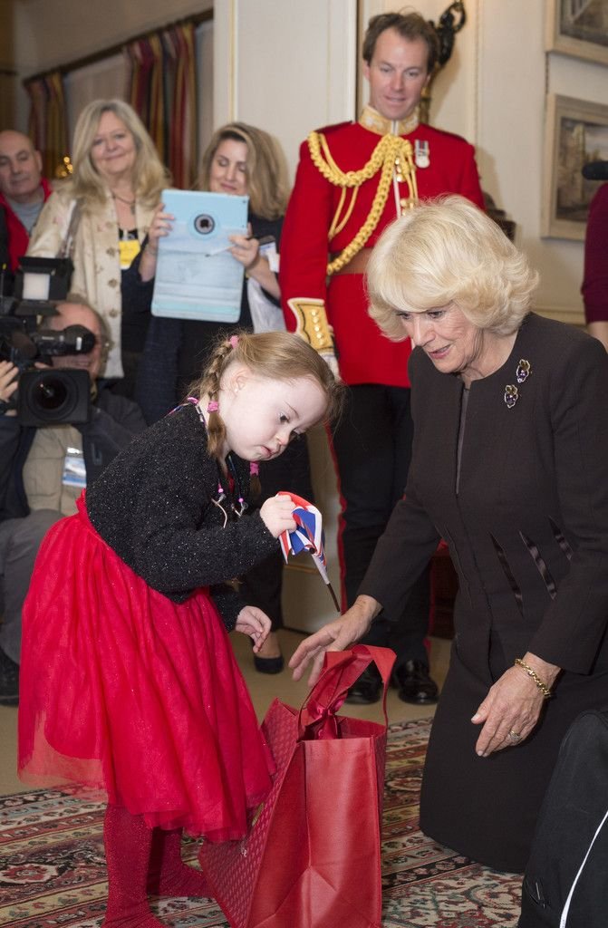 Kiera Holland, 5, receives Christmas presents from the