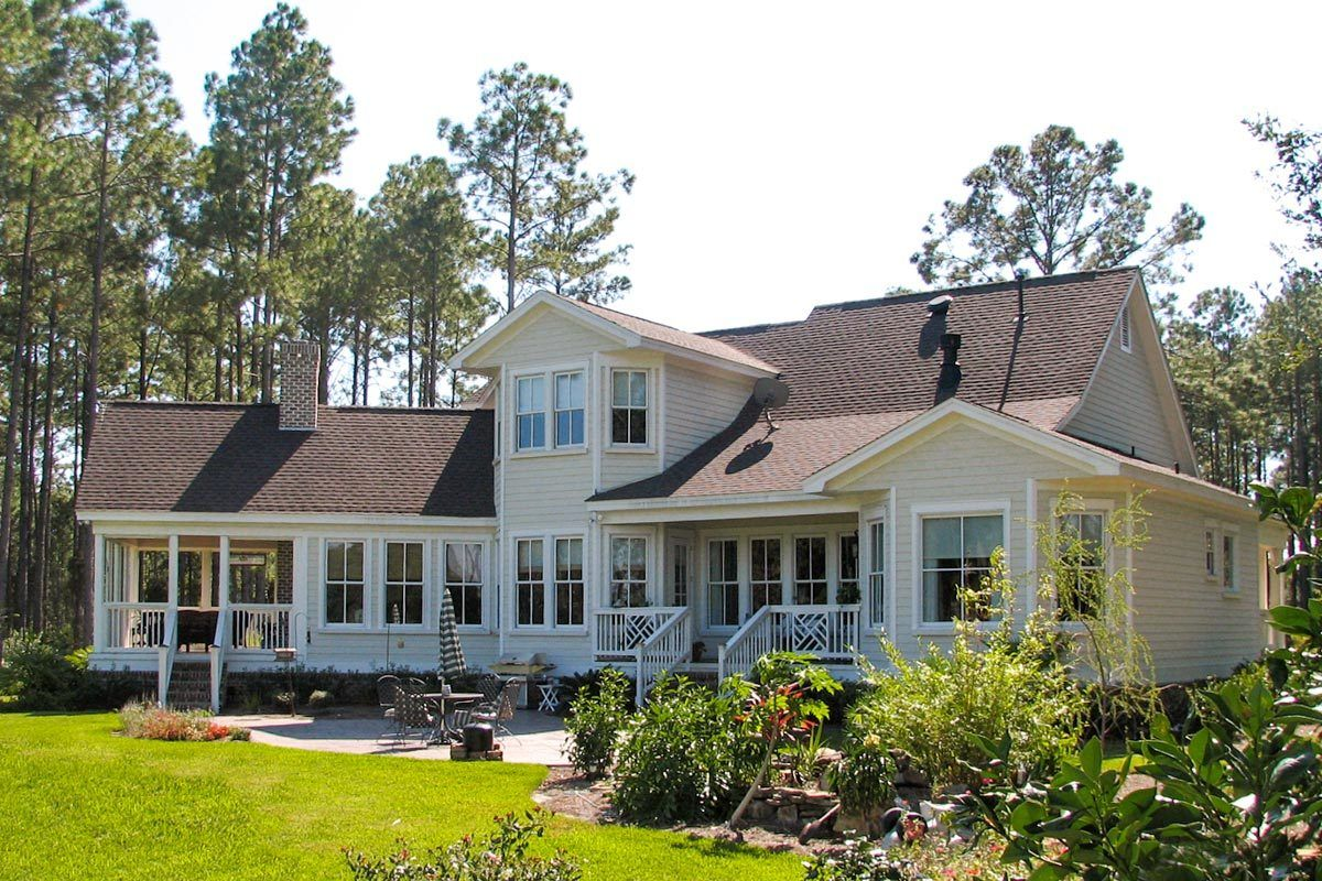 Plan 25652GE: Modern Farmhouse Plan with Generous Outdoor ... on Farmhouse Outdoor Living Space id=95060