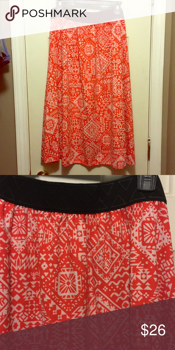59bfb36348 Lularoe XL Lola Lularoe XL Lola. Reddish-orange and white with black waist  band. Washed but never worn. Smoke-free house. LuLaRoe Skirts Midi