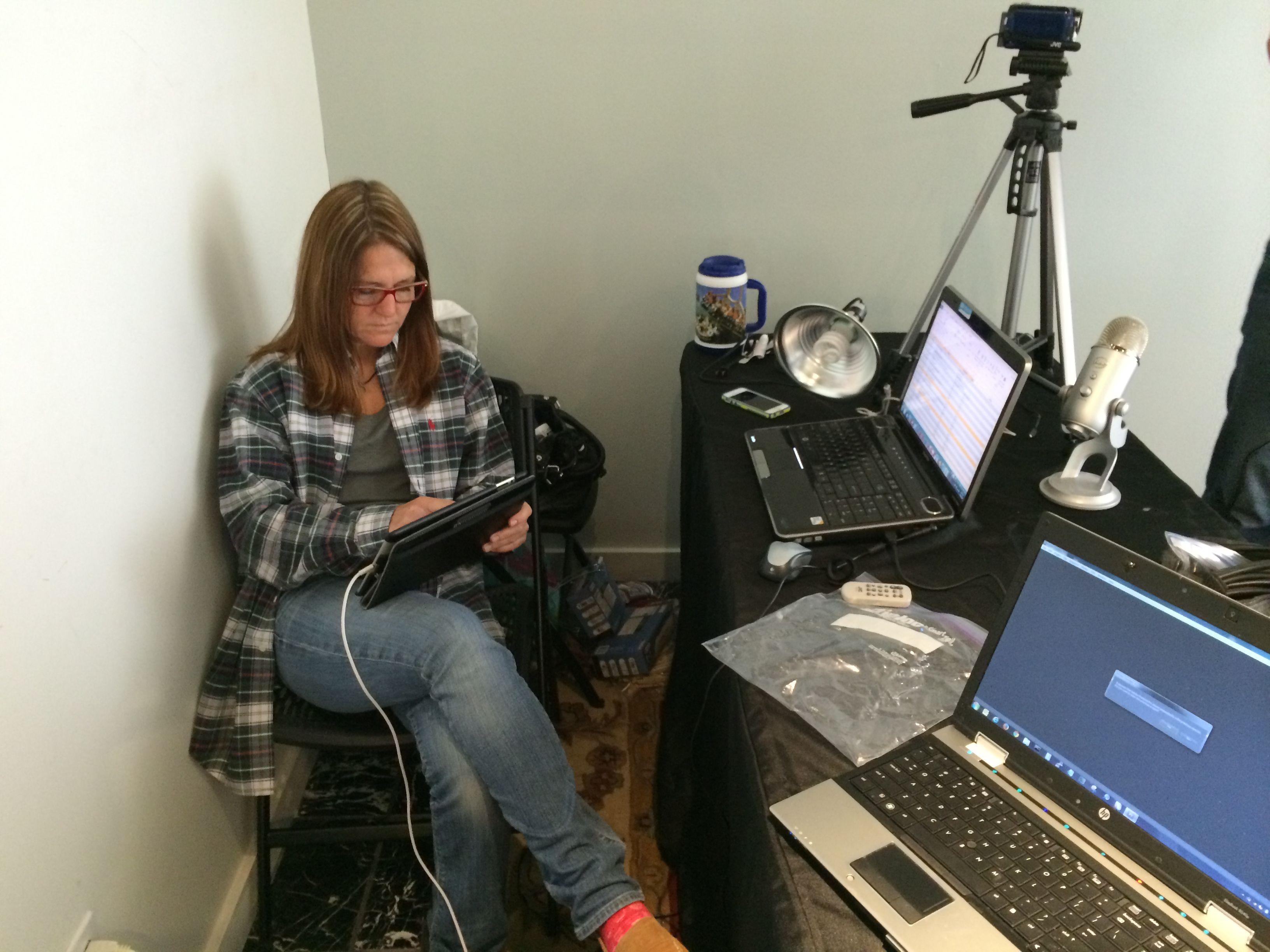 Sara, creative director for Slapshotstudio.com, is reviewing script titles in between shots.